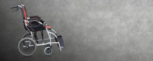 Side View Di Cut Black And Orange Wheel Chair On Gray Background, Object, Copy Space