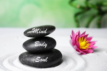 Stones With Words Mind, Body, Soul And Lotus Flower On White Sand. Zen Garden