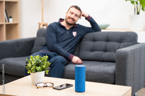 Man using home assistant bluetooth speaker Canvas Print