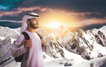 Arab Man Climbing Mountain For...