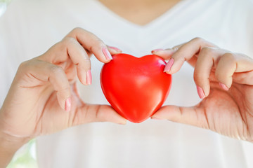 woman hand holding red heart ,healthcare ,donation ,love concept