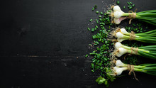 Green Onion On A Wooden Table. Fresh Vegetables. Top View. Free Space For Text.