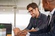 Leinwanddruck Bild - Businessmen working together at desk