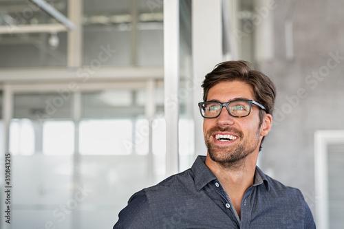 Obraz na plátně  Happy businessman having idea at office