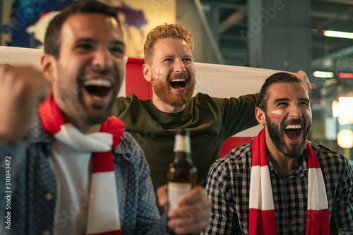 Photo Supporters watching football match on TV