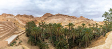 Beautiful Green Mountain Oasis In Tunisia. Chebika Oasis In Tozeur Governorate. Horizontal Panoramic Color Photography. Aerial Top View.