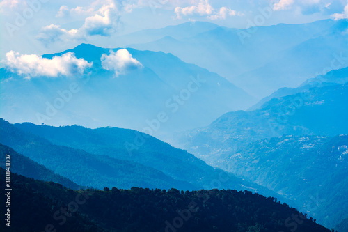 Mountains in blue tone with clouds, travel in India, Himalayas Range, landscape Wallpaper Mural