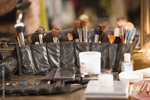 Fototapeta Professional cosmetics brushes on dressing table
