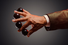 Magician Shows Trick With Magic Balls. Sleight Of Hand. Manipulation With Props.