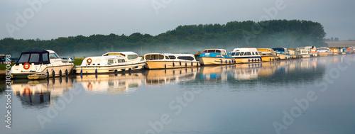 Fototapeta Boats at dawn, Norfolk Broads, England obraz