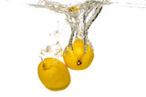 whole lemon, half and sliced slices falls under water
