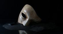 White Opera Mask On The Sand