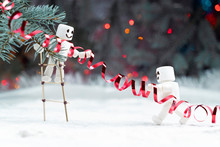 Two Smiling Snowman Characters...