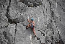 Beautiful Girl Climbing Rock