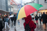 Fototapeta Tęcza - Portrait on back view of woman walking in the street with rainbow umbrella