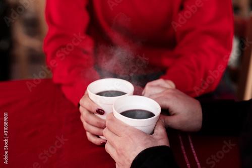 couple enjoying hot wine punch claret on christmas market - 310889801