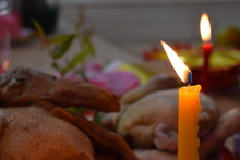 Lighting Candle And Food To Pa...