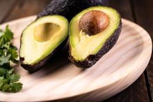 Avocado Split In Half On Wood. Healthy And Vegetarian Food