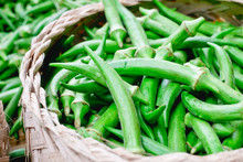 Freshly Picked Organic Okra (AKA Ladies' Fingers Or Ochro) In A Bamboo Basket, Is Rich In Dietary Fiber And Has Many Health Benefits. Selective Focus. Copy Space.