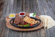 Combo Fajita; Top Down Photo Of Mexican Steak And Chicken Fajitas In Iron Skillet With Corn Tortillas