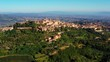 Authentic village of Montepulciano. A beautiful old town with red roofs in Tuscany, Italy. Perfect for travels and vacations - aerial view with a drone