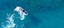 Aerial Drone Ultra Wide Top View Photo Of Jet Ski Water Craft Cruising In Deep Blue Mediterranean Sea