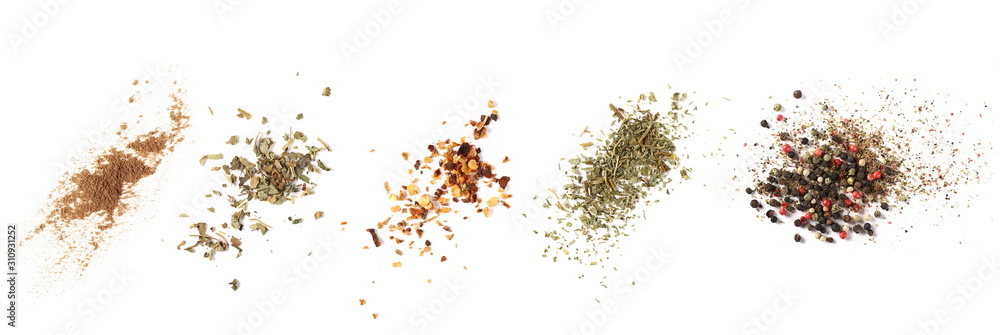 Set cinnamon powder, basil, ground dry chili pepper, parsley, colorful pepper grain and minced, background, top view texture