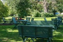 Stadsparken With Wooden Benches In Uppsala, Sweden