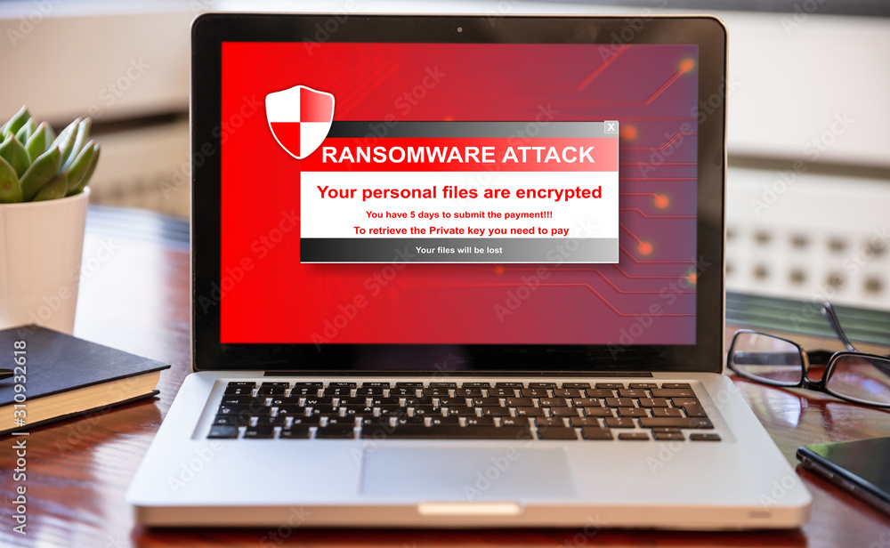 Fototapeta Ransomware attack concept. Ransomware text on a laptop screen