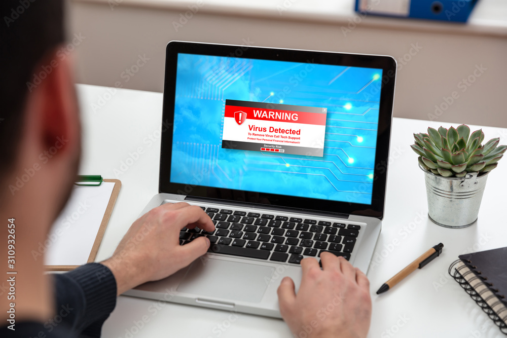 Fototapeta Virus detected warning text on a laptop screen
