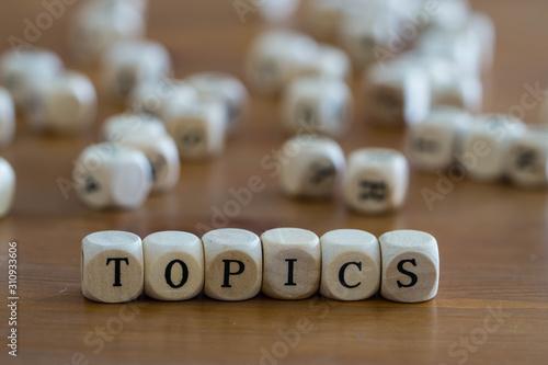 Fototapeta  Topics written with wooden cubes