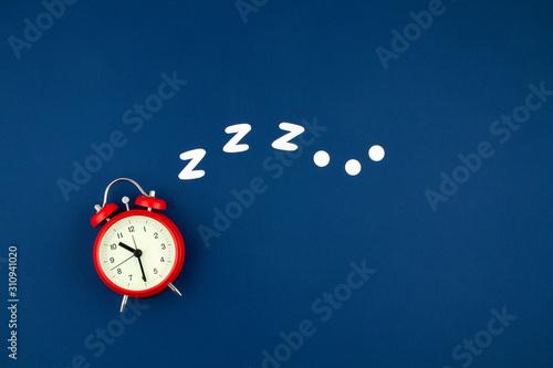 Snoring classic alarm clock on blue pastel trendy background Canvas Print