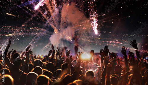 crowd with raised hands at concert festival banner - 310942037