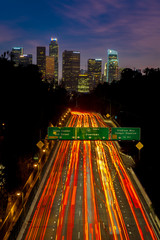 JANUARY 20, 2019, LOS ANGELES, CA, USA - Pasadena Freeway (Arroyo Seco Parkway) CA 110 leads to downtown Los Angeles with streaked car lights at sunset