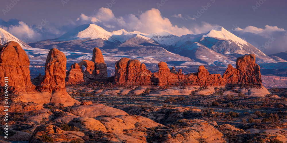 Fototapeta FEBRUARY 15, 2019 -  ARCHES NATIONAL PARK, UTAH , USA - Arches National Park, Utah at sunset - Lasalle Mountains in distance
