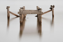 Broken Wooden Pier With Blurre...