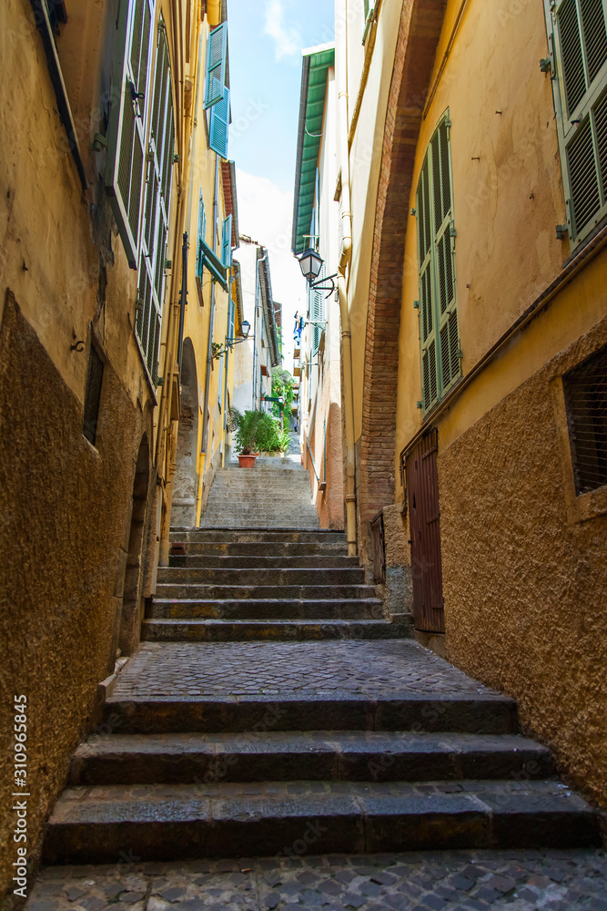 Villefranche-sur-Mer, France, October 10, 2019. Picturesque street with stairs in the old town