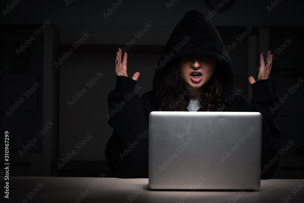 Fototapeta Female hacker hacking security firewall late in office