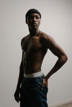 Studio Portrait Of Muscular Male Model Posing Shirtless