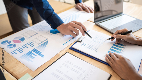 Business People Meeting to analyse and discuss and brainstorming the financial report chart data in office, Financial advisor teamwork and accounting concept Wallpaper Mural