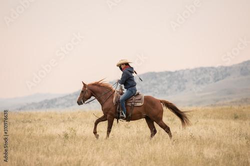 Fototapeta Cowgirl On Horse obraz