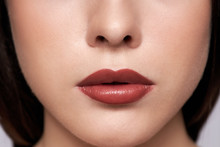 Perfect Red Lips Makeup. Close Up Macro Photo With A Beautiful Female Mouth. Full Lips Full. Large Detail Of The Face. Perfect Clear Skin, Light Fresh Lip Makeup.