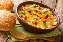 Hearty Cheeseburger Soup With Vegetables, Beef, Bacon And Cheese Close-up In A Bowl. Horizontal