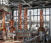 Stills In A Warehouse Distillery
