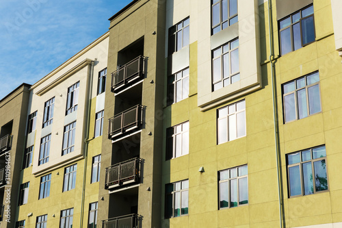 Exterior view of typical multifamily mid-rise residential building used rental apartments, college dorms, condominiums Wallpaper Mural