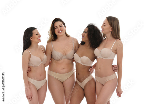 Obraz Group of women with different body types in underwear on white background - fototapety do salonu