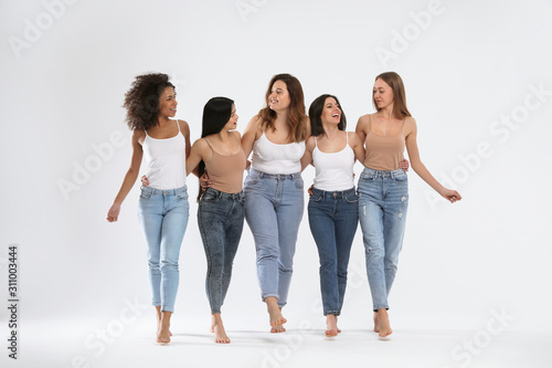 Obraz Group of women with different body types on light background - fototapety do salonu