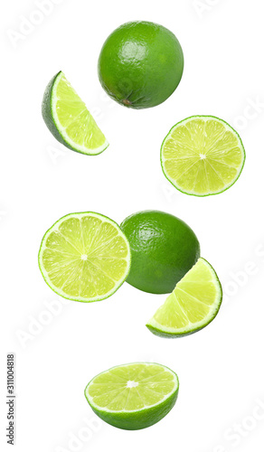 Valokuva Collage of falling limes on white background