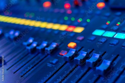 Obraz na plátně  modern electronic mixing console in neon light