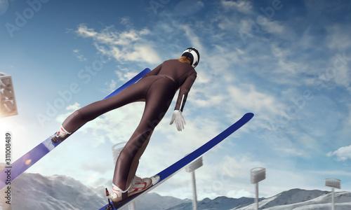 Skier in flight. Ski jumping on sunset.